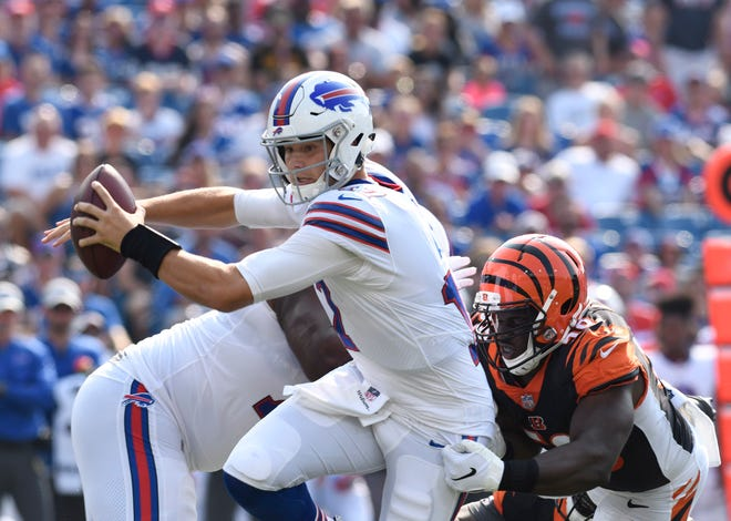 Aug 26, 2018; Orchard Park, NY, USA; Buffalo Bills quarterback Josh Allen (17) is sacked by Cincinnati Bengals defensive end Carl Lawson (58) during the first quarter of a game at New Era Field.
