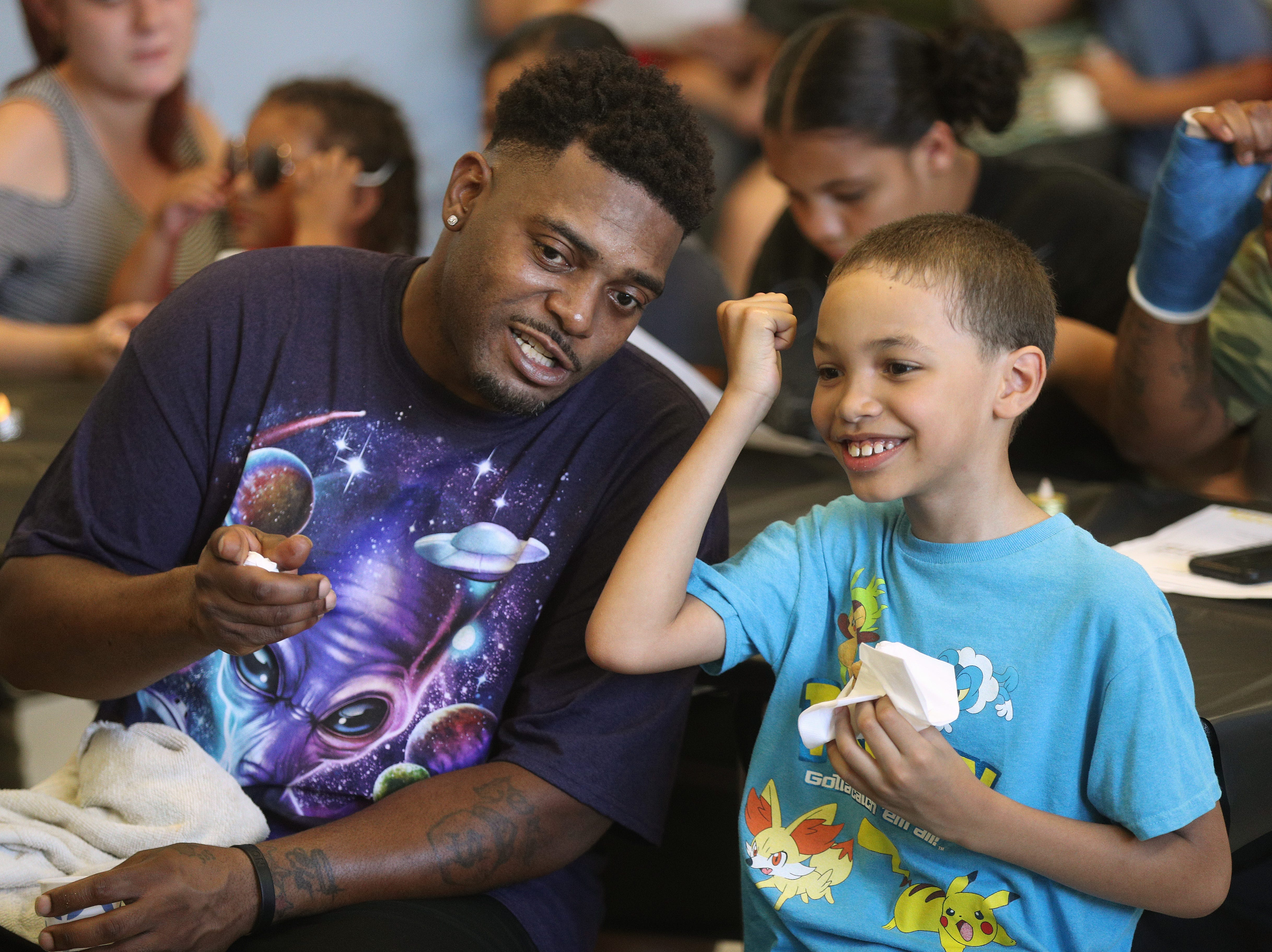 Second-grader Chaos Rhodes with his father Henry Rhodes visit RISE Community School before the start of the school year.