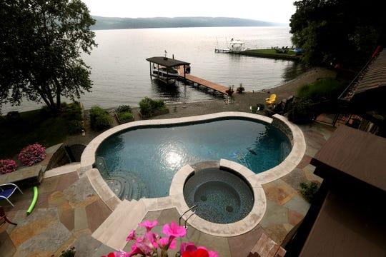Three decks in the pool area overlook Seneca Lake.