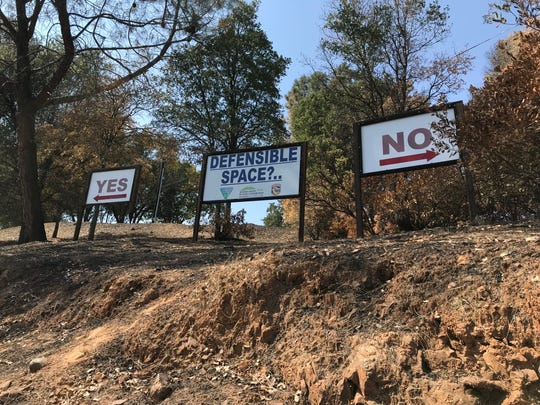 Firefighters at Cal Fire Station No. 58 want passers-by to know the proper way to prepare outdoor space. The display is off Homestake Road and Highway 299 on Tuesday, Aug. 28, 2018.