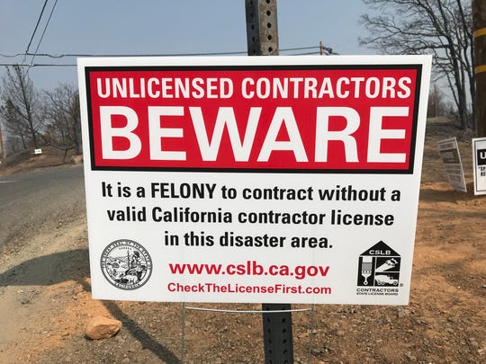 Carr Fire fraud warning sign in Redding.