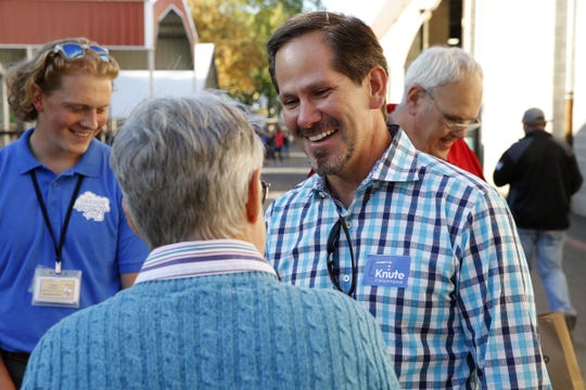 Republican candidate for governor Rep. Knute Buehler, R-Bend, talks with Gretchen Goodall of Gresham at the Oregon State Fair in Salem, Oregon, on Friday, August 24, 2018.