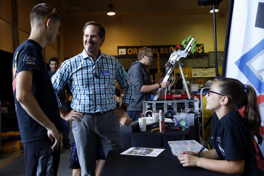 Republican candidate for governor Rep. Knute Buehler, R-Bend, chats with Cody Thomas (left) and Jesslyn Humber of First Tech at the Oregon State Fair in Salem, Oregon, on Friday, August 24, 2018.