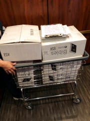 In this Aug. 10, 2018, photo provided by Tommy Danielsen, boxes of Bibles sit in a cart at Sheraton Rockville Hotel in Rockville, Md.   Marriott International, which bought Starwood two years ago, has begun putting copies of the Bible and the Book of Mormon in Sheratons, Westins and other hotels in the Starwood family. Marriott says it expects to place the books in 300,000 rooms by the end of this year.