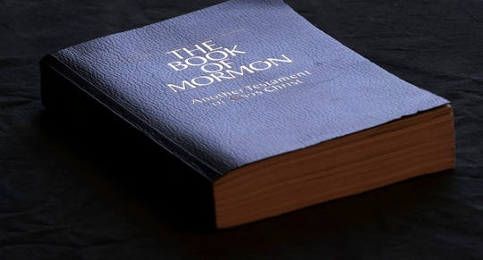 The Book of Mormon is shown Tuesday, Aug. 21, 2018, in Salt Lake City. Sheraton, Westin and other Starwood hotels are finding their religion. Marriott International, which bought Starwood two years ago, has begun putting copies of the Bible and the Book of Mormon in Sheratons, Westins and other hotels in the Starwood family.