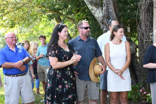 Jeannie Mariner with daughter Brittany Mariner, CEO and President, and her husband Barry during the Windmill Creek Vineyard & Winery opening in Berlin, Md. on Tuesday, August 29, 2018.