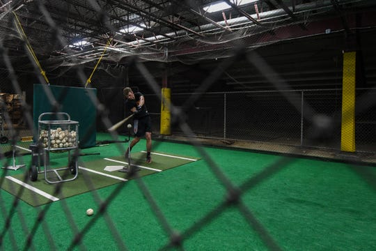 Shorebirds player Will Robertson practices in the batting cage before the game on Monday, Aug. 20.