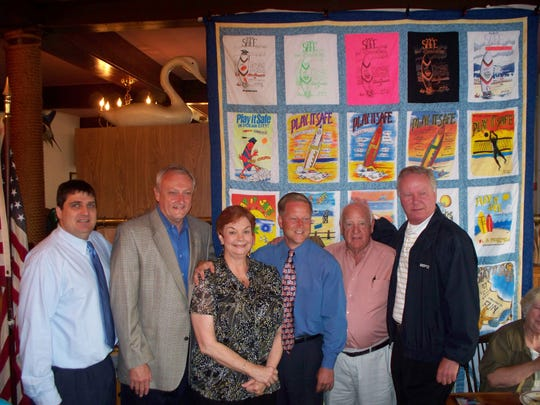 """In this file photo, From left, Ocean City Councilman Joe Hall, Delegate Jim Mathias, Chairwoman Donna Greenwood, Congressman Frank Kratovil, former Mayor Roland """"Fish"""" Powell and Ocean City Mayor Rick Meehan stand in front of the """"Play It Safe Ocean City 20th Anniversary Quilt"""" at the Play It Safe Ocean City Kick Off Breakfast at Hall's Family Restaurant in 2012."""