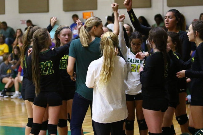 The Calvary volleyball team prepares to hit the court in a recent jamboree game.