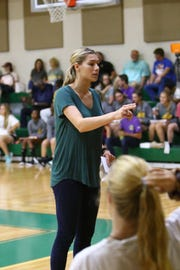 Calvary volleyball coach Jessica McClendon gives her team last minute instructions in a recent jamboree game.