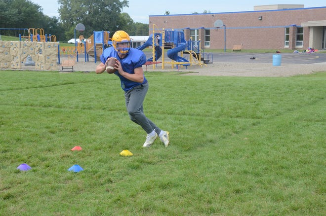 Baltic quarterback Sam Muston practices on Aug. 28 at Baltic High School.