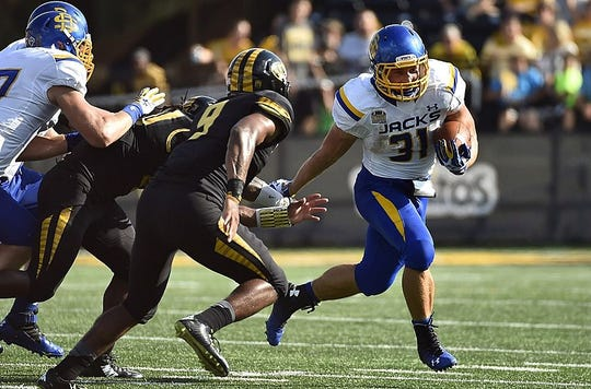 Aug 30, 2014; Columbia, MO, USA; South Dakota State Jackrabbits running back Zach Zenner (31) runs the ball against the Missouri Tigers during the second half at Faurot Field. Mandatory Credit: Jasen Vinlove-USA TODAY Sports