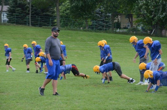 Alan Baskerville, the head football coach for Baltic, oversees a practice.