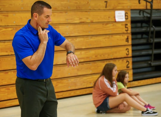 Levi Neville checks his pulse along with his students during his physical education class at Wilson's Creek Intermediate School on Wednesday, Aug. 29, 2018.