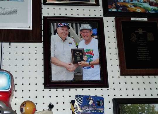 Springfield has an enthusiastic group of Route 66 buffs. A photo of Bud Perry (pictured on left) with David Eslick is on a wall inside Bud's Tire and Wheel. Eslick helped start the Birthplace of Route 66 Festival in 2011. Bud's Tire and Wheel was the site of that first festival.