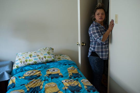 Carolina Isabel Iraheta stands in the room she prepared for her two sons in an apartment she rented in Arlington, Va., as part of her effort to win their release from U.S. custody.