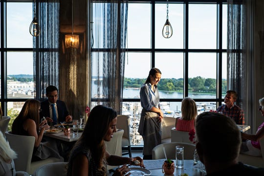 A server works a busy dinner service at La Vie.