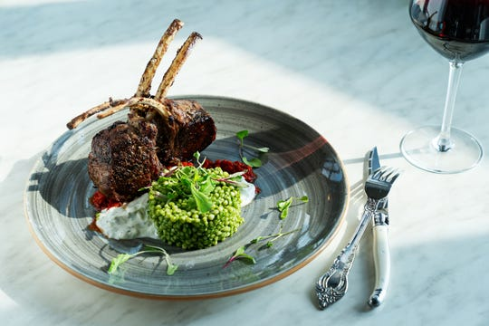 Lamb chop with herbed couscous.