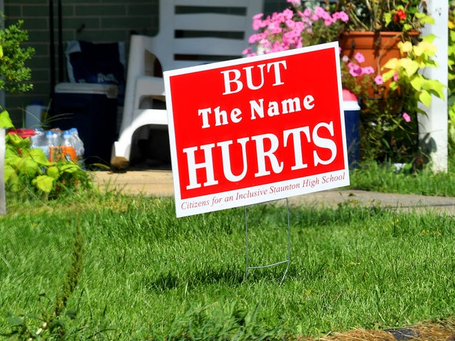 "Sharon Wells displays a ""But The Name Hurts"" sign in her front yard in Staunton."