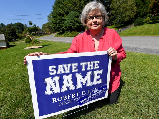 "Sondra Shaner kneels next to the ""Save the Name"" sign in her front yard in Staunton on Wednesday, August 29, 2018. Shaner has lived in Staunton most of her life and graduated from Robert E. Lee High School in 1964."