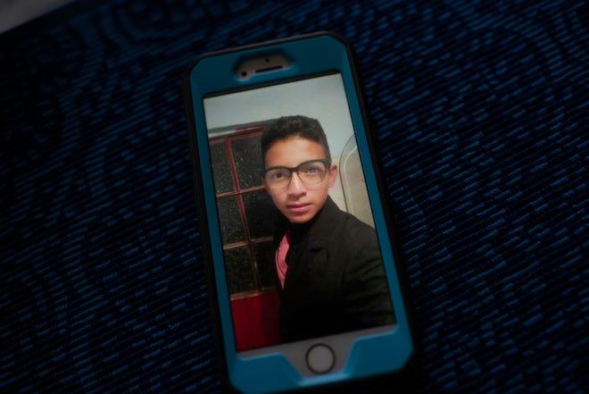 Iraheta's phone shows a photograph of her son Diego Hernandez, 15.