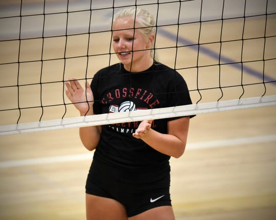 Abby Medelberg claps for a teammate during practice Tuesday, Aug. 28, at Cathedral High School.