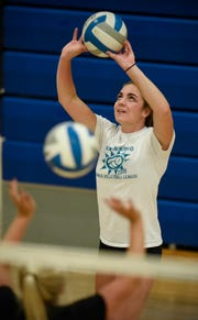 Megan Voit concentrates on the ball during practice Tuesday, Aug. 28, at Cathedral High School.