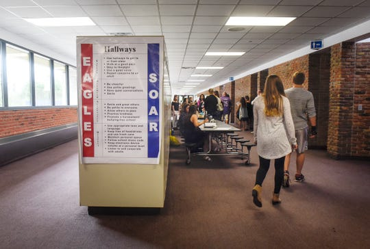 Students walk between stations Tuesday, Aug. 28, during a back-to-school open house event at Apollo High School in St. Cloud.