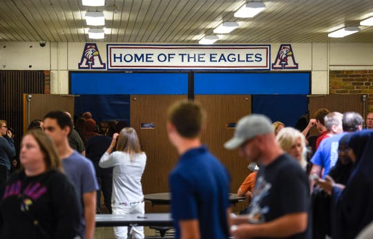 Students and family members move between stations Tuesday, Aug. 28, during a back-to-school open house event at Apollo High School in St. Cloud.