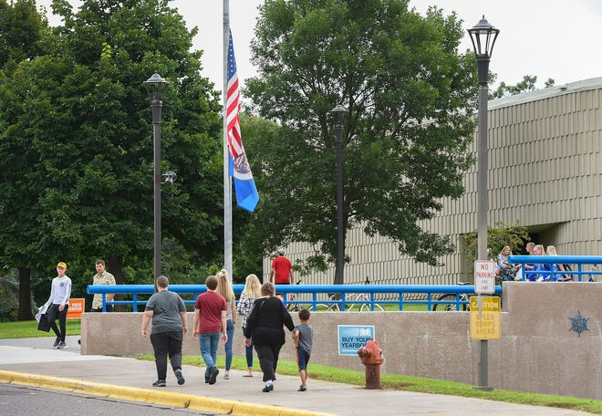 A steady stream of students and parents visit an open house Tuesday, Aug. 28, at the Sartell High School.