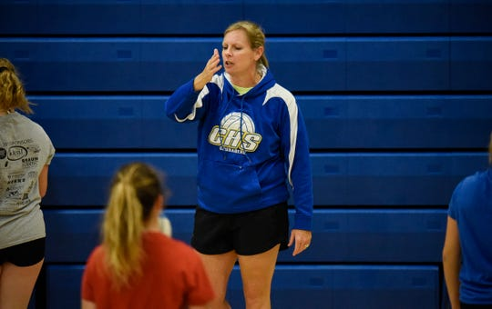 Head coach Glenda Prom gives instructions to her team during practice Tuesday, Aug. 28, at Cathedral High School.