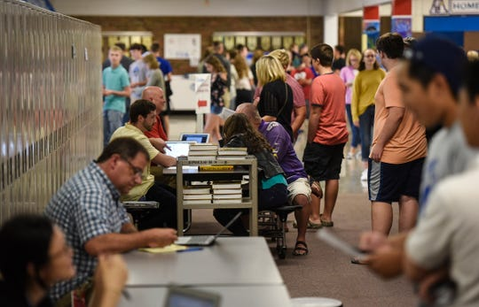 Students meet their teachers in classes for the upcoming year Tuesday, Aug. 28, during a back-to-school open house event at Apollo High School in St. Cloud.