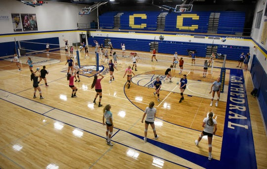 Cathedral volleyball players fill the gym floor during the start of a practice session Tuesday, Aug. 28, at Cathedral High School.