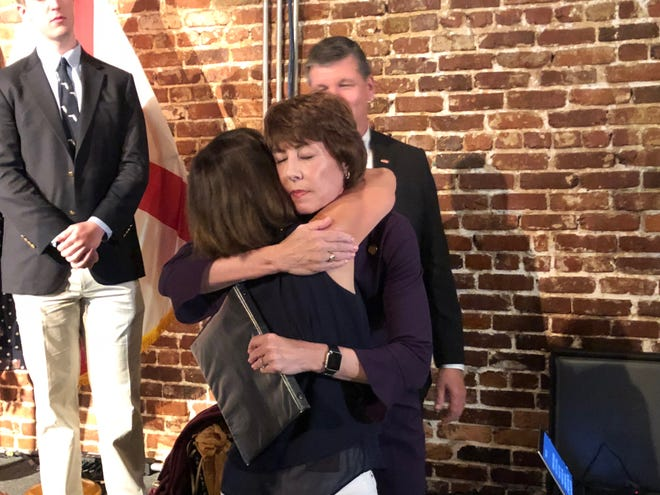 Gwen Graham hugs a supporter after addressing a disappointed but encouraging crowd.