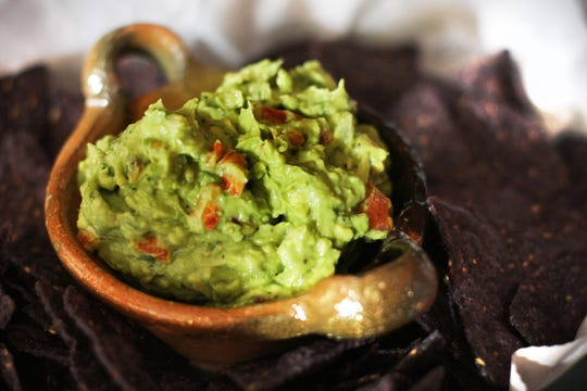 Guacamole with tomato salsa makes a great tailgate treat.