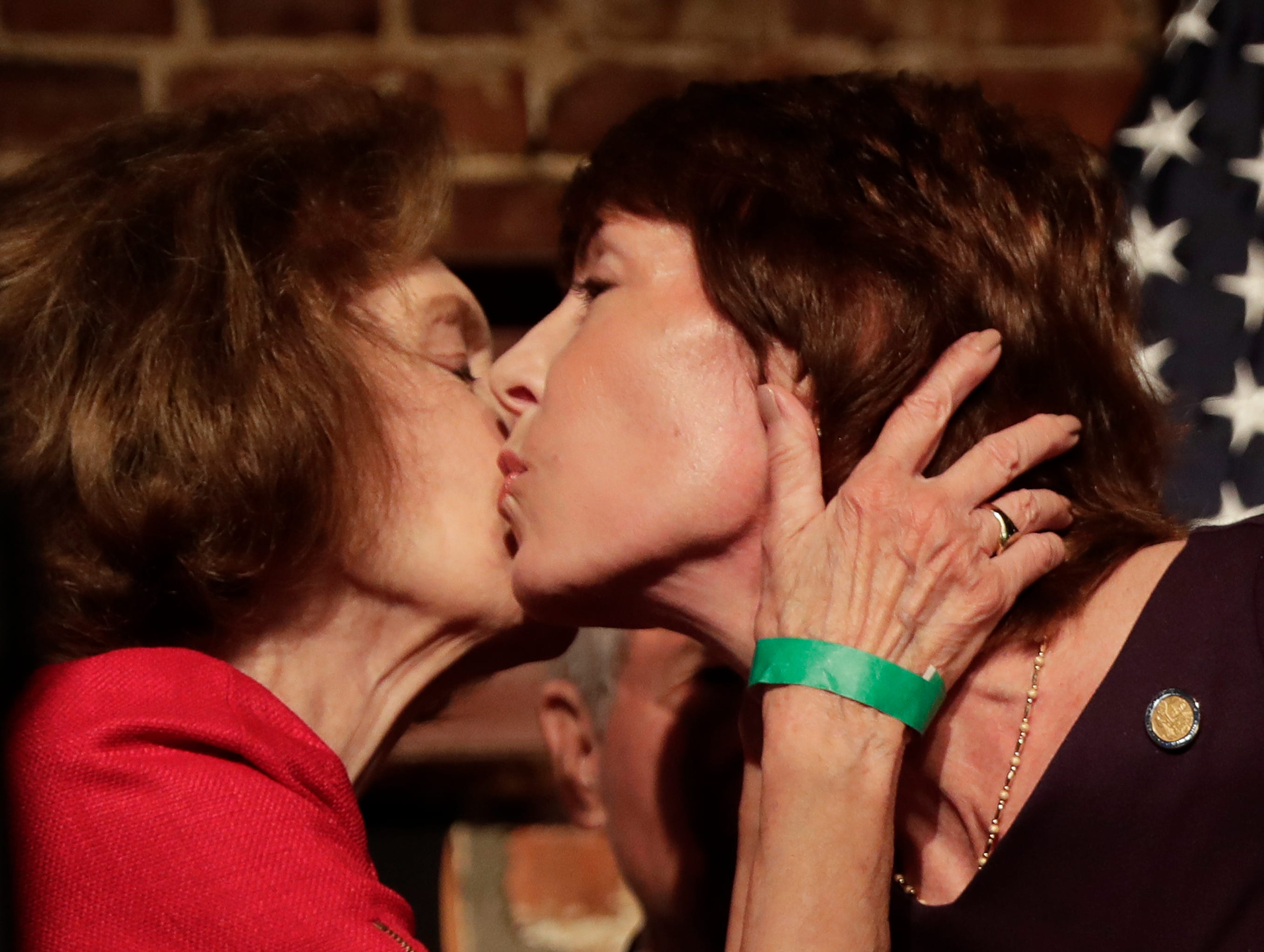 Democratic gubernatorial candidate Gwen Graham, right, gets a kiss from her mother Adele at an primary election party after she lost to opponent Andrew Gillum, Tuesday, Aug. 28, 2018, in Orlando, Fla. (AP Photo/John Raoux)