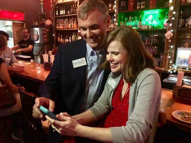 Rick Minor and his wife Jessica Lowe-Minor watch election results come in on their cellphones. Rick Minor held off four competitors to be elected to the Leon County Commission Tuesday night.