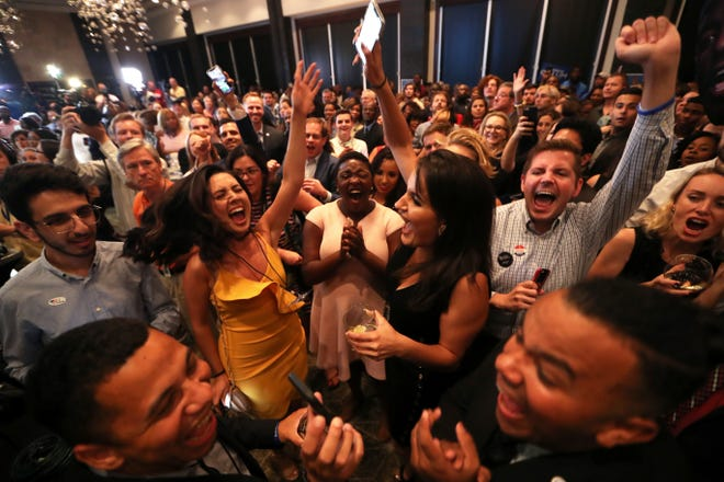 Supporters of democratic gubernatorial nominee Andrew Gillum celebrate his victory during his election watch party at Hotel Duval on Tuesday, Aug. 28, 2018.