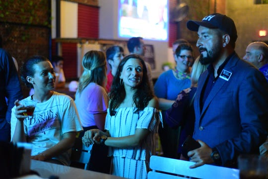 Supporters for Tallahassee mayoral candidate Dustin Daniels, right, gather for a watch party at Township on Tuesday.