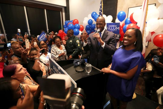 Democratic gubernatorial nominee Andrew Gillum celebrates his victory with supporters during his election watch party at Hotel Duval on Tuesday, Aug. 28, 2018.