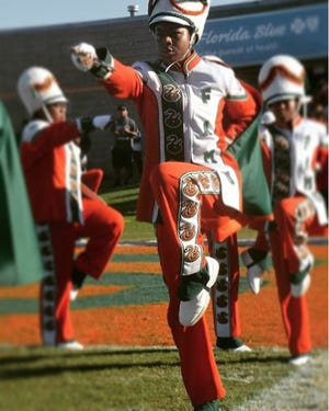 Cori Bostic performing with the Marching 100.