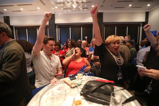 Tyler Clark, from left, Kara Weaver and Terri Lipsey Scott cheer on gubernatorial candidate Andrew Gillum during his watch party at the Hotel Duval downtown Tallahassee, Fla. on Tuesday, Aug. 28, 2018.
