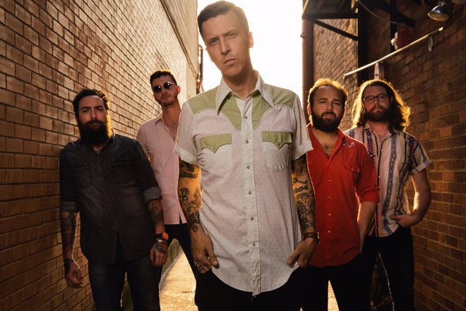 BJ Barham, foreground, went out and got new members of his band American Aquarium.