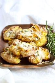 Parmesan Truffle Smashed Potatoes with rosemary are over the top tasty.