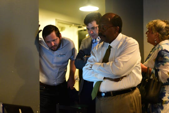 Tallahassee city commissioner Curtis Richardson, right, Max Herrle, center, and city commissioner candidate Jeremy Matlow watch the polls at Gaines Street Pies on Tuesday.