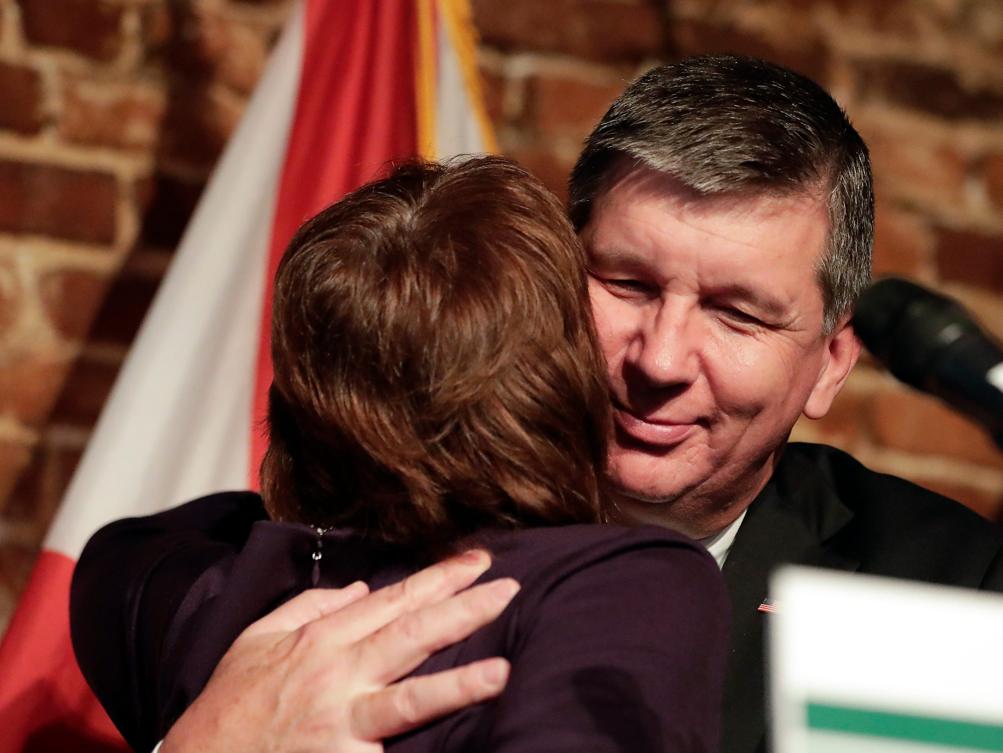 Democratic gubernatorial candidate Gwen Graham, left, gets a hug from her husband Stephen Hurm after she gave her concession speech at a primary election night party Tuesday, Aug. 28, 2018, in Orlando, Fla. Andrew Gillum won the Democratic primary and will go on to face Republican Ron DeSantis in November. (AP Photo/John Raoux)