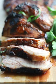 Pork steaks reversed seared and sliced for an easy Labor Day cookout.