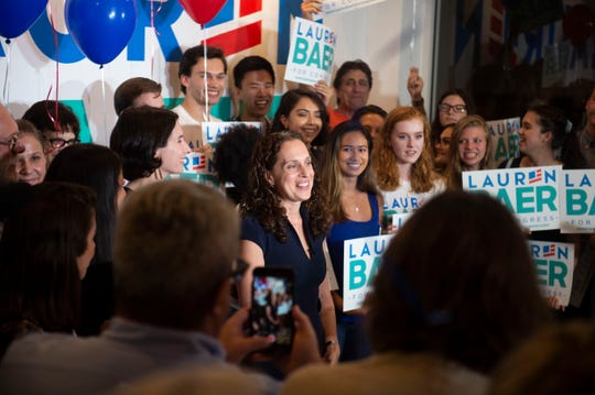 Democrat Lauren Baer, of Palm Beach Gardens, celebrates her victory in the U.S. House District 18 race against Pam Keith on Tuesday, Aug. 28, 2018, during her primary election night party at her campaign office in Jupiter. Baer, a former Obama administration foreign policy advisor, will be facing incumbent U.S. Rep. Brian Mast in the Nov. 6 general election.