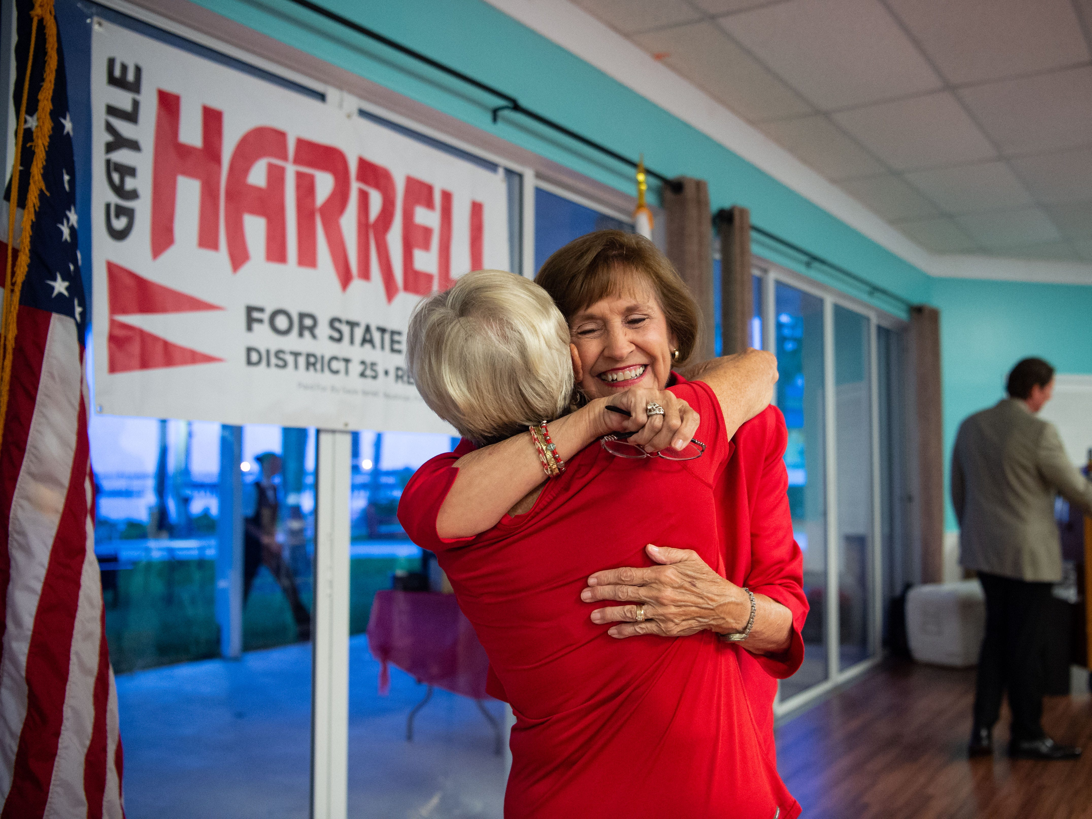 """State Rep. Gayle Harrell (center) embraces decades-long friend and supporter Annie MacMillan, of Stuart, after the announcement of Harrell's win over Belinda Keiser for the Republican Party nomination Tuesday, Aug. 28, 2018, to run for the Senate Dist. 25 seat being vacated by Sen. Joe Negron. """"We've done it before, we'll do it again,"""" said MacMillan, attending a primary elections party in downtown Stuart, regarding the upcoming midterm elections."""