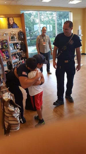 Lil' Feetboard members, the SLC School District Homeless Department, and St. Lucie County Firefighters were on hand to help children select a new pair of shoes.